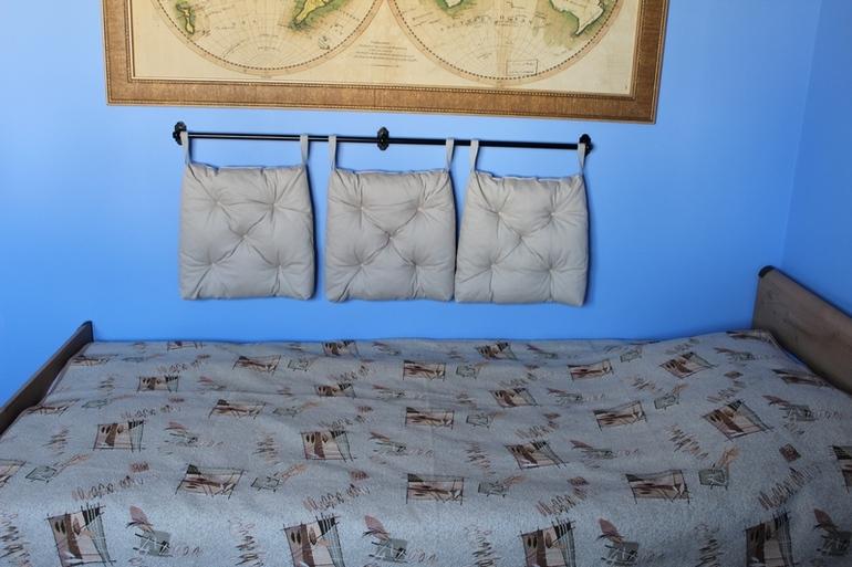 Коврики над кроватью